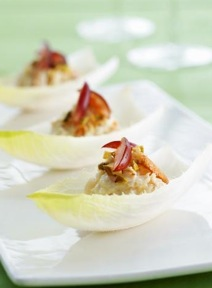 ... in its own little endive boat filled with crabmeat corn and a festive